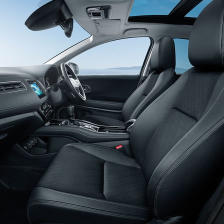 Honda HR-V side facing view of interior seats and dashboard.