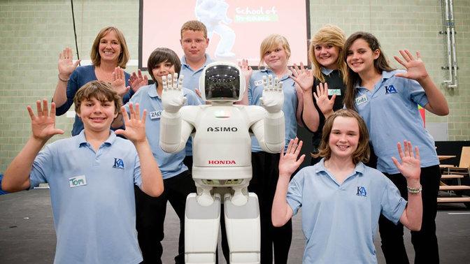 Asimo and pupils at Honda's School of Dreams.