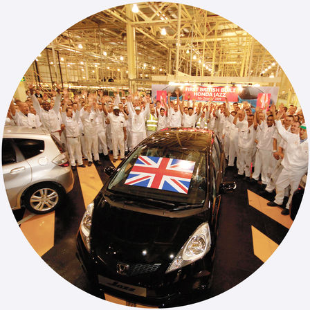Aerial view of Honda Jazz with factory workers.
