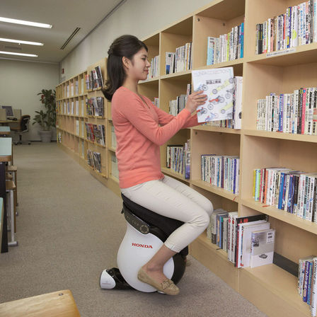 Honda Uni Cub being used in a library.